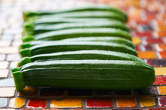 Mini zucchini vegetables in a row Royalty Free Stock Photography
