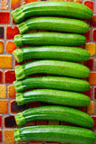 Mini zucchini vegetables in a row Stock Photography