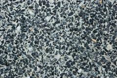 Mini zwarte steen in concrete muur Royalty-vrije Stock Afbeelding