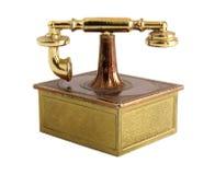 Miniatura de bronze do telefone do vintage imagens de stock