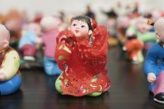 Miniatura de uma menina chinesa da minoria, Pequim Dashanzi Art District da arte Imagem de Stock Royalty Free