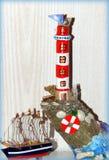 ` Miniatura del faro y de la nave del ` fotos de archivo