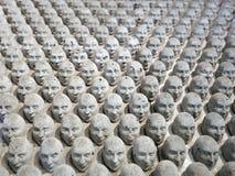 Miniatura della scultura delle teste Immagine Stock