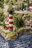 Miniatura do farol, o litoral, a costa de mar, verão imagens de stock