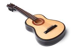 Miniature acoustic guitar Stock Image