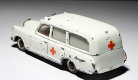 Miniature ambulance. A miniature scale model of a white  ambulance with a red cross Stock Images