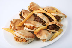 Miniature Arab shwarmas. Some chicken others beef, in little kubus breads with french fries on a plate Royalty Free Stock Photos