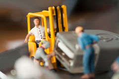Miniature Artisans Doing Maintenance Stock Photo