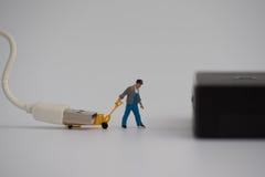 Miniature avec la prise ou le câble de chargeur pour la banque se reliante de puissance Images libres de droits