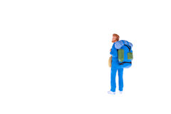 Miniature backpacker people isolate on white background. Close up of Miniature backpacker people isolate on white background. Elegant Design with copy space for Stock Image