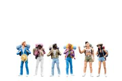 Miniature Backpacker , Tourist people isolated on white background Stock Images