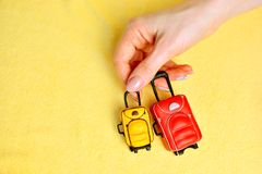 Miniature baggage in female hands. Luggage background royalty free stock images