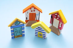 Miniature Beach Houses. On Blue Background stock image