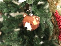 MINIATURE BEAR CHRISTMAS TOY ON THE FIR TREE Royalty Free Stock Image