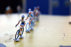 Miniature Bike Racers. Miniature bike racing figures riding the Tour de France royalty free stock images