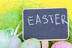 Miniature blackboard with easter eggs Royalty Free Stock Image