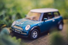 Free Miniature Blue Tin Car Closeup In Forest Royalty Free Stock Photos - 184137678