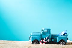 Miniature blue truck with surfboard and buoy. On a bright blue background royalty free stock images