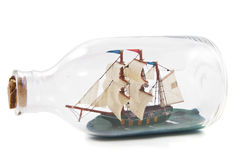 Miniature boat in bottle Royalty Free Stock Photos