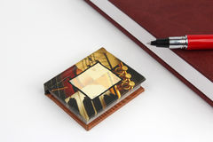 Miniature book on the background of the usual books Royalty Free Stock Images