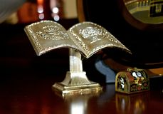 Miniature bookstand and miniature chest. Great books and secrets in small chests. Royalty Free Stock Photos