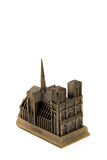 Miniature bronze copy of Notre. Dame de Paris cathedral isolated on white background Royalty Free Stock Photography