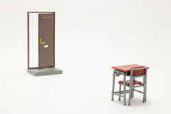 Miniature of brown half open door and school study desk. Miniature of brown half open door and school study desk on white background Royalty Free Stock Image