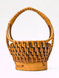 A miniature brown wicker basket isolated on white  Stock Photo