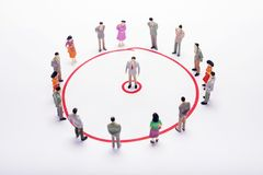 Miniature business people circle scheme over white backdrop or b. Ackground Stock Photos