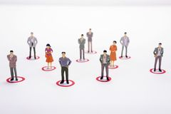 Miniature business people in conection scheme over white backdro. P or background Stock Photo