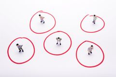 Miniature business people in conection scheme over white backdro. P or background Stock Images