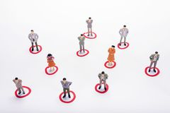 Miniature business people in conection scheme over white backdro. P or background Stock Photos