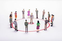 Miniature business people in conection scheme over white backdro. P or background Royalty Free Stock Photography