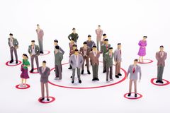 Miniature business people in conection scheme over white backdro. P or background Stock Image