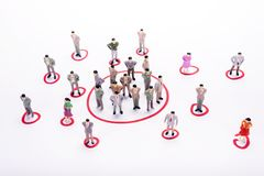 Miniature business people in conection scheme over white. Backdrop or background Stock Photo