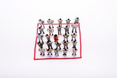 Miniature business people in conection scheme square over white. Backdrop or background Stock Images