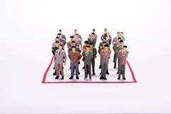 Miniature business people in conection scheme square over white. Backdrop or background Stock Photography