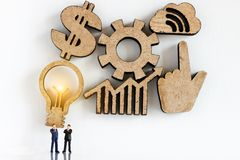 Miniature business people with graph and dollar sign. Agreement, partnership and business concept. stock images
