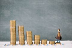 Miniature business people stand on pile of money coin, Travel saving and planing concept stock photos