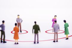 Miniature business people standing in diagrams, smile over white. Bacground Stock Photography