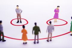 Miniature business people standing in diagrams, smile over white. Bacground Royalty Free Stock Photography