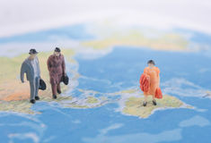 Miniature business people travel on world map. business internat. Ional travel concept Royalty Free Stock Image