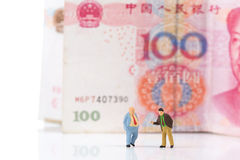 Miniature businessman figurine running on a euro banknote Royalty Free Stock Photos