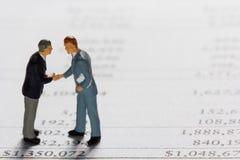 Miniature businessmans on report. Miniature businessman on report. Business concept Stock Image