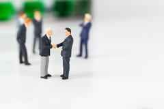 Miniature businessmen Stock Photography
