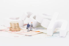 Miniature businessmen shaking hands Royalty Free Stock Image