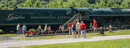 Miniature C&O Train Ride. Clifton Forge, VA – June 3rd: Children enjoying a miniature C&O train ride with the Presidential Express in the background at the Royalty Free Stock Image