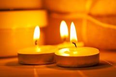 Miniature candles on a bamboo mat. Miniature candles burning on a bamboo mat Stock Image