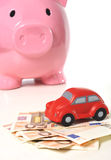 Miniature car and euro banknotes Royalty Free Stock Images