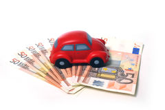Miniature car and euro banknotes 01 Royalty Free Stock Image